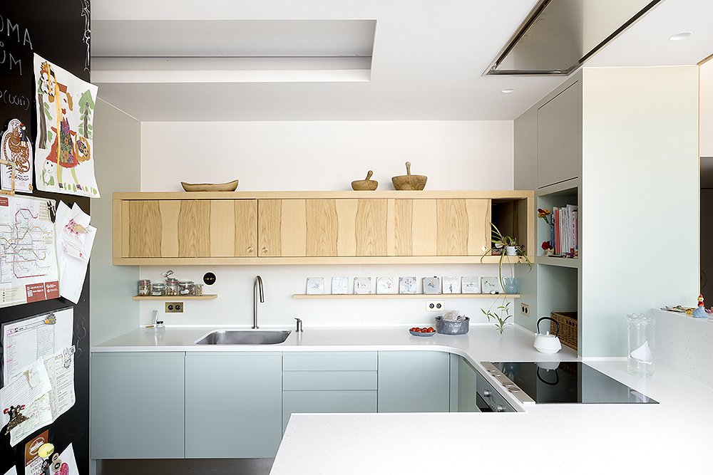 Kitchen, Wood Cabinet, Undermount Sink, Cooktops, and Wall Oven  Photo 11 of 18 in A Dreamy Loft in Prague With Castle Views and an Onyx Moon