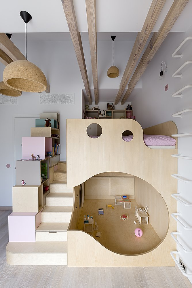 Kids Room, Bedroom Room Type, Bunks, Bed, Shelves, Storage, Pre-Teen Age, Girl Gender, and Light Hardwood Floor  Photo 15 of 18 in A Dreamy Loft in Prague With Castle Views and an Onyx Moon