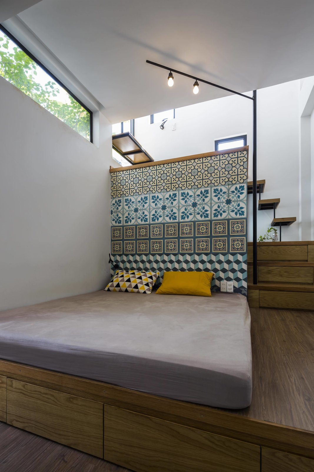Bedroom, Bed, Floor, and Medium Hardwood  Best Bedroom Medium Hardwood Floor Photos from See How This Compact Home in Vietnam Makes the Most of 194 Square Feet