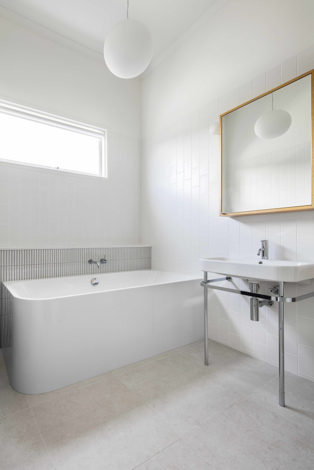 Bath Room, Pendant Lighting, Subway Tile Wall, Freestanding Tub, and Pedestal Sink  Photos from 2 New Gable Roofs Brighten Up an Edwardian Cottage in Melbourne