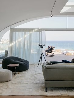 "This two-story, three-bedroom penthouse located at the top of the multi-use development of Pacific Bondi Beach was designed to evoke the ""relaxed sophistication"" of its chic Australian beach locale."