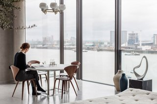 In London's Greenwich Peninsula (a part of London's undergoing cultural facelift), boutique real estate brand Aucoot and the team behind UK magazine Cereal styled this 1,793-square-foot, three-bedroom penthouse apartment, transforming it into a simple yet stunning home.