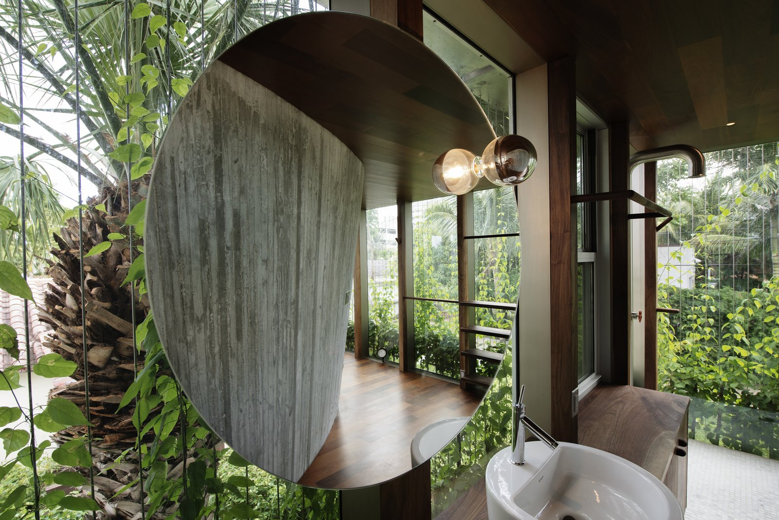 Bath, Vessel, Wood, Ceramic Tile, Accent, and Open  Best Bath Wood Accent Photos from A Restaurateur's Mythical Home in Miami Follows the Path of the Sun