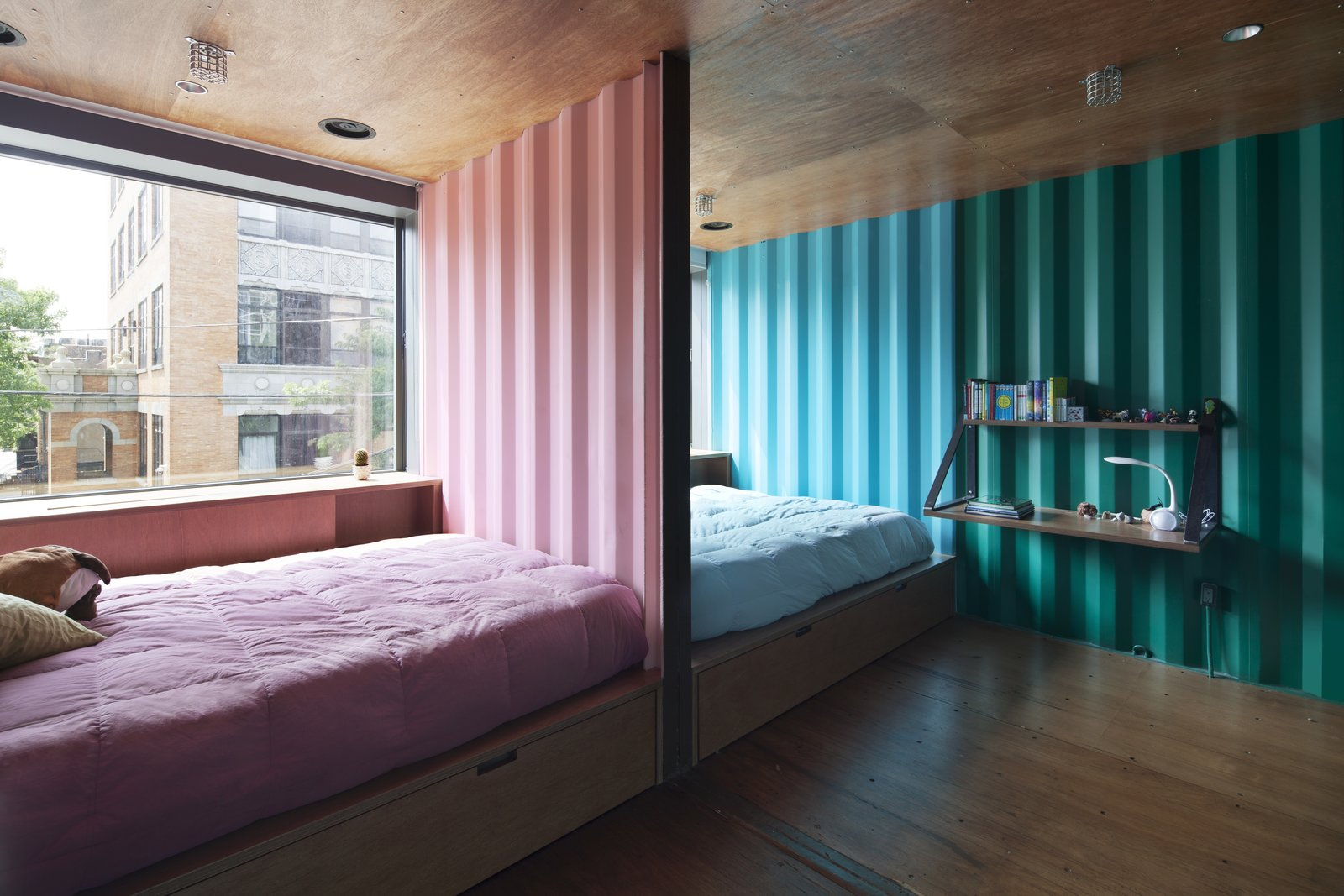 Bedroom, Bed, Shelves, Recessed Lighting, and Medium Hardwood Floor  Photo 10 of 13 in An Amazing Home in Brooklyn Made Out of 21 Shipping Containers