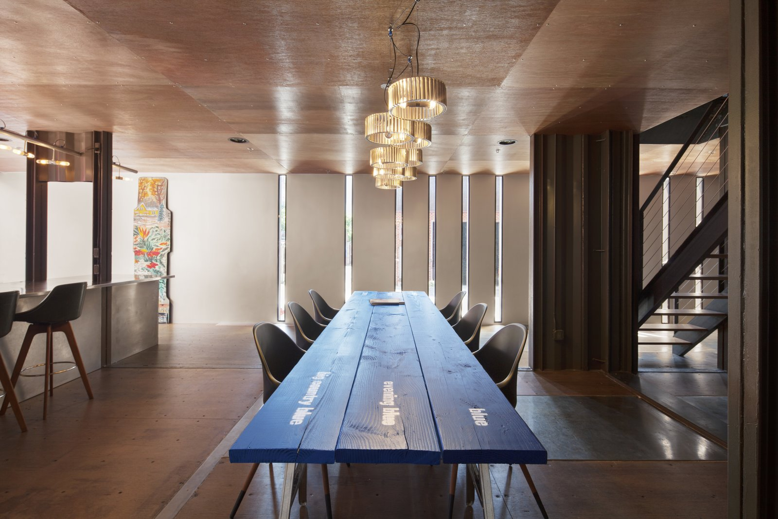 Dining Room, Medium Hardwood Floor, Pendant Lighting, Chair, Table, Stools, and Bar  Photo 11 of 13 in An Amazing Home in Brooklyn Made Out of 21 Shipping Containers