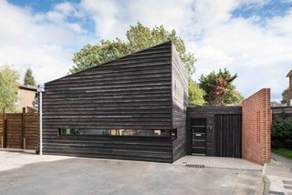 A collaboration between London practice RDA Architects and prefab and modular builders Boutique Modern, this seven-module prefab is clad in shou sugi ban timber with fit-outs selected by the owner.