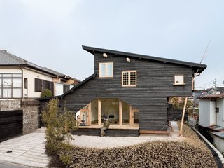 Another charred wood siding residence by Fujimori, the compact Coal House has a tearoom on the second story that's accessible from the exterior by a timber ladder, and from the interior by a secret door in the master bedroom.