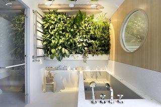 Dwell's Top 10 Bathrooms of 2017 - Photo 5 of 10 - Step into a bright and airy apartment that shows how important the smallest details can be. Designed by A1 Architects, the Onyx Moon Loft is located in the district of Malá Strana on Prague's Kampa Island. The owner of the 2,368-square-foot residence splits his time between the Czech Republic and Japan, so it's no surprise that hints of these influences reveal themselves throughout the space, including concentric circles, matte-wood surfaces, brass etchings, and walls painted with flowers.