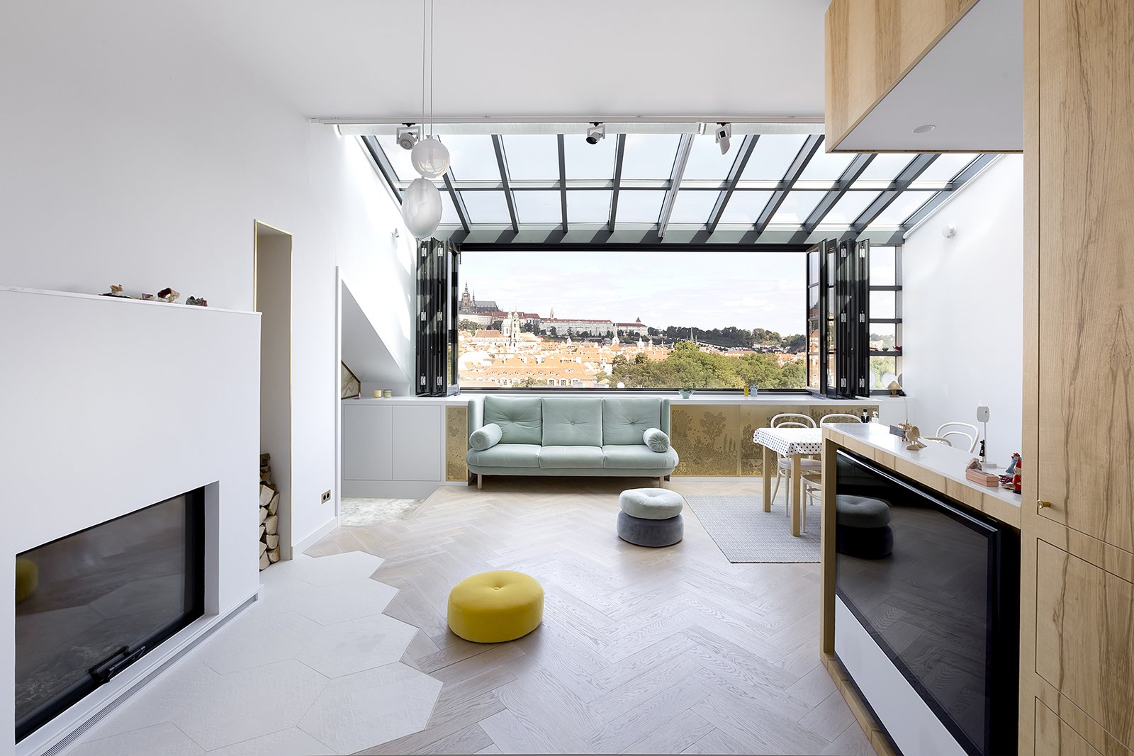 Living, Sofa, Ottomans, Standard Layout, Pendant, Track, Table, Light Hardwood, Rug, Chair, Bar, and Storage  Living Storage Table Bar Photos from A Dreamy Loft in Prague With Castle Views and an Onyx Moon
