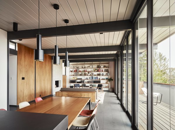 Living Room, Pendant Lighting, Shelves, Sofa, Chair, Rug Floor, Wood Burning Fireplace, Standard Layout Fireplace, Floor Lighting, and Table  Best Photos from See the Careful Transformation of a Midcentury Eichler in San Francisco
