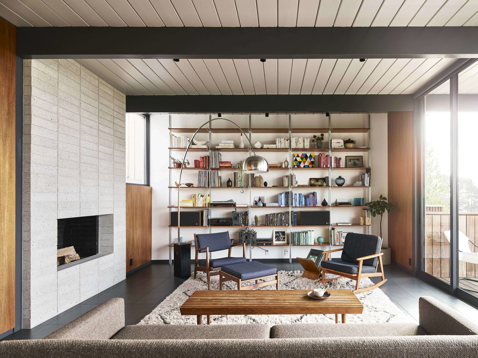 Living, Wood Burning, Shelves, Ottomans, Chair, Coffee Tables, Sofa, Rug, Standard Layout, and Floor  Best Living Standard Layout Photos from See the Careful Transformation of a Midcentury Eichler in San Francisco