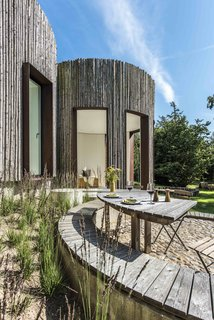 Stay in This Danish Vacation Home Made Up of 9 Log-Clad Cylinders - Photo 3 of 14 -