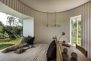 Stay in This Danish Vacation Home Made Up of 9 Log-Clad Cylinders - Photo 9 of 14 -