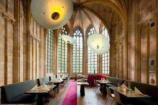 "This renovated, 15th-century monastery of the ""Crutched Friars"" is now the 60-room Kruisherenhotel Maastricht hotel, where tall cathedral windows bring in tons of light and add historic grandeur to the restaurant, which was previously the monastery's old church."