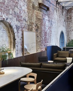A former power station in Melbourne's city center was repurposed into Higher Ground, a chic restaurant with six new connected levels. Melbourne-based studio DesignOffice preserved the old building's large arched windows and nooks.