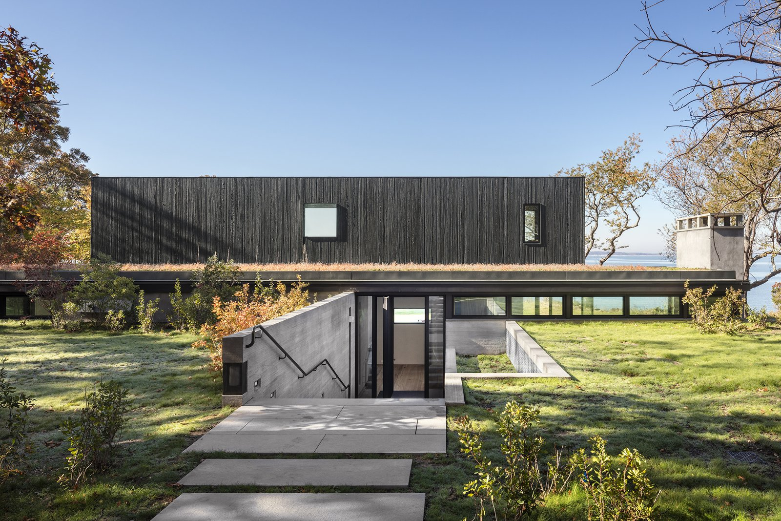 Exterior, House Building Type, Wood Siding Material, Concrete Siding Material, and Flat RoofLine  Photo 3 of 13 in An Incredible Cedar-Clad House Captures Views of the Sea and Forest