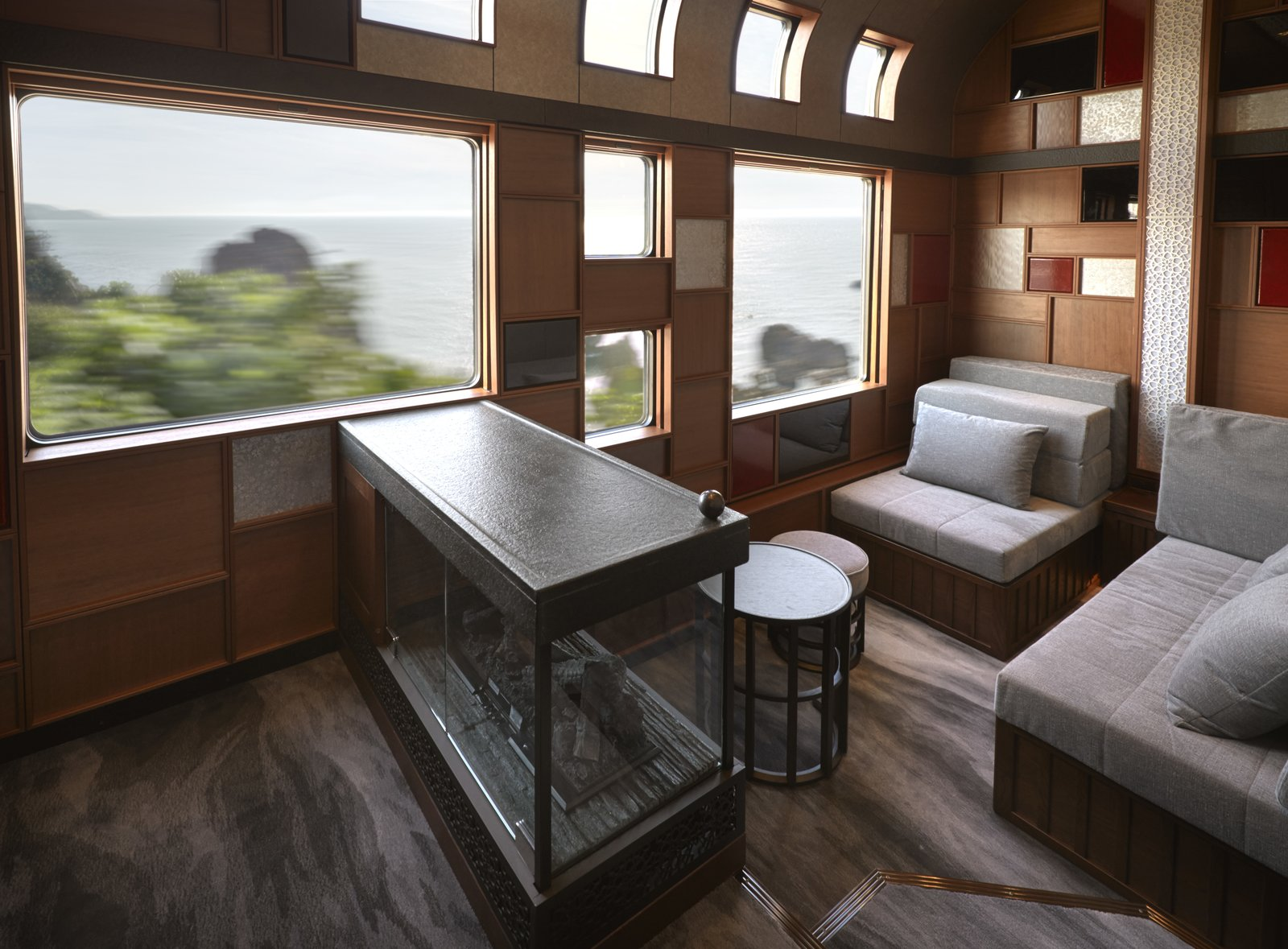 Living Room, Chair, Ottomans, End Tables, and Gas Burning Fireplace  Photo 3 of 14 in Journey Through Eastern Japan on a Luxury Sleeper Train