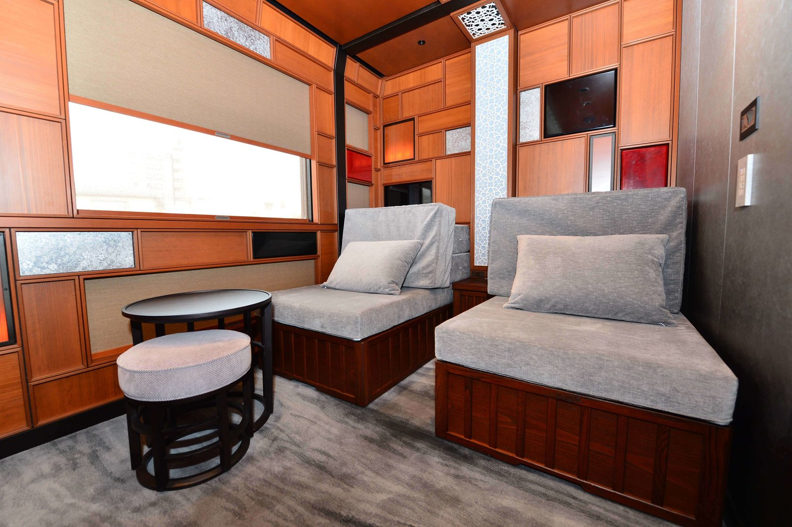 Living Room, Chair, Ottomans, and End Tables  Photo 12 of 14 in Journey Through Eastern Japan on a Luxury Sleeper Train