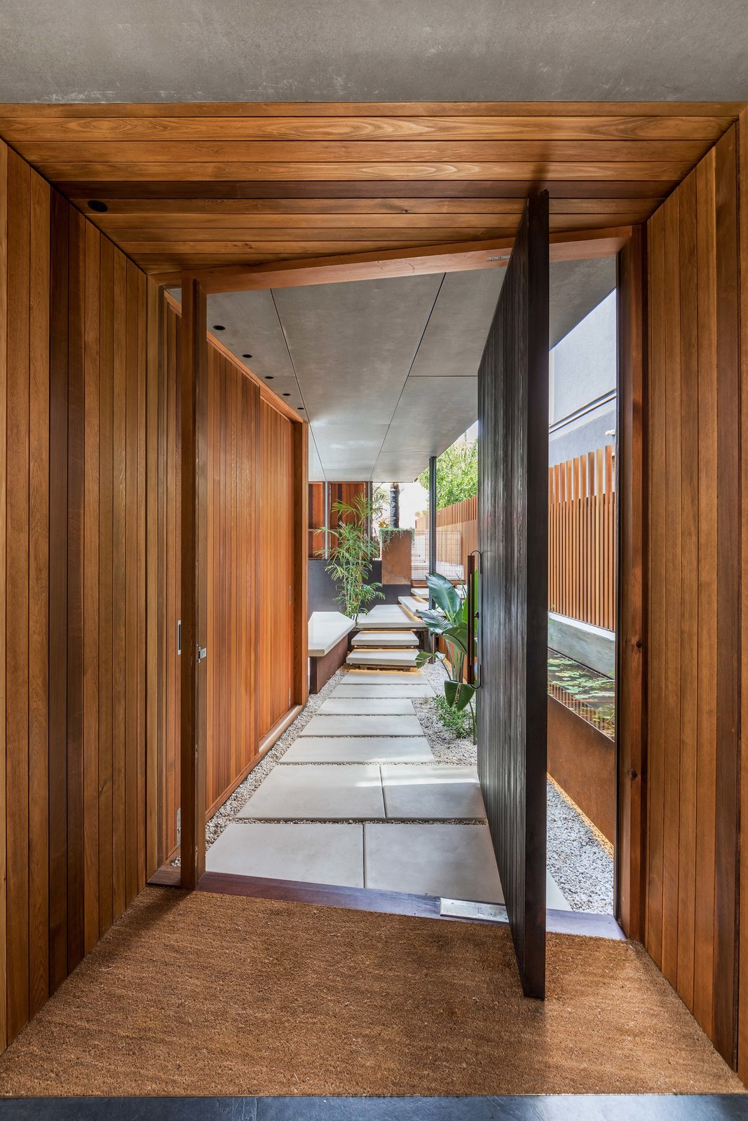 Doors, Wood, Exterior, and Swing Door Type  Photo 10 of 19 in Living Screens Conceal a North Bondi Beach House and a Semi-Indoor Pool
