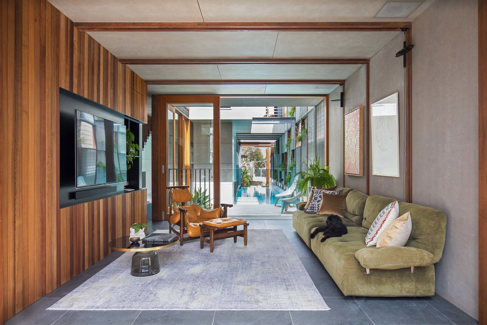 Living Room, Sofa, Chair, Coffee Tables, Concrete Floor, and Rug Floor  Photo 9 of 19 in Living Screens Conceal a North Bondi Beach House and a Semi-Indoor Pool