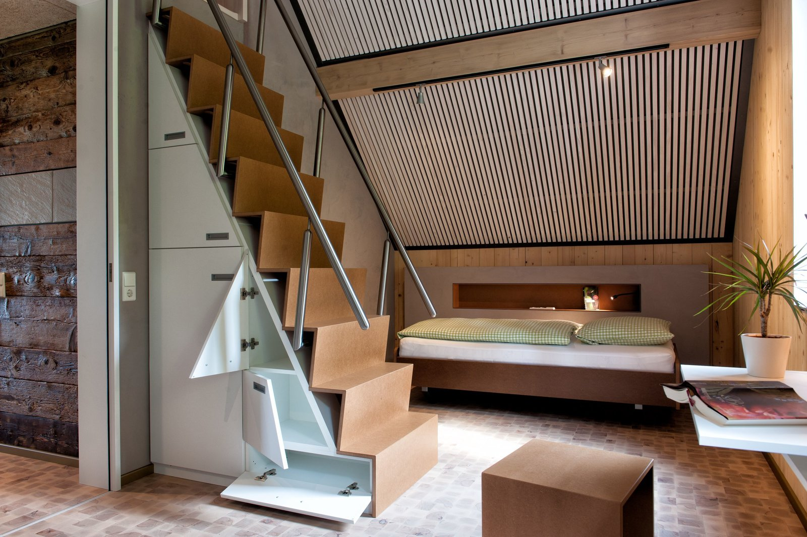 Staircase, Wood Tread, and Metal Railing  Photo 5 of 9 in These 4 European Homes Show How Striking a Steep Roof Can Be