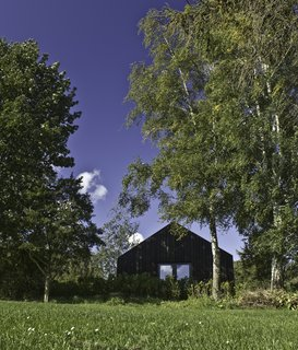Designed by Copenhagen-based, German architect Jan Henrik Jansen, this vacation home on the Danish island of Møn is available for rent through Urlaubsarchitektur. Built with dark timber, the pure form of the structure creates lofty interiors that offer unobstructed views of the surrounding meadows.