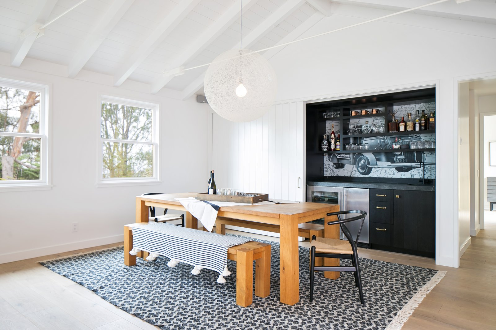 Dining Room, Bench, Light Hardwood Floor, Rug Floor, Chair, and Pendant Lighting  Best Photos from A 1950s California Ranch House Gets a Modern-Farmhouse Makeover