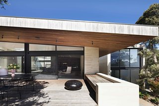 Australian architecture practice Robson Rak designed this 4,844-square-foot home near a beach in Victoria, Australia, with multiple outdoor terraces and expansive glazed doors to frame interesting internal perspectives. They also connect the internal spaces with the limestone landscape.