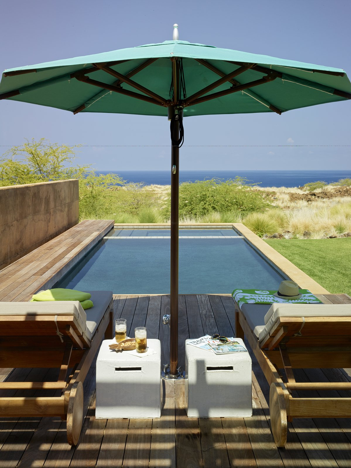 Outdoor, Walkways, Small Pools, Tubs, Shower, Grass, Shrubs, Small Patio, Porch, Deck, Wood Patio, Porch, Deck, and Decking Patio, Porch, Deck  Photo 12 of 20 in An Incredible Home in Hawaii That's As Much Fun As Summer Camp
