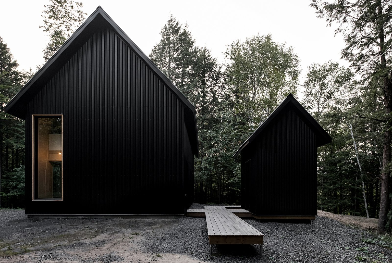 Exterior, Cabin Building Type, Metal Siding Material, and Gable RoofLine  Photo 5 of 17 in A Lofty Nature Retreat in Quebec Inspired by Nordic Architecture