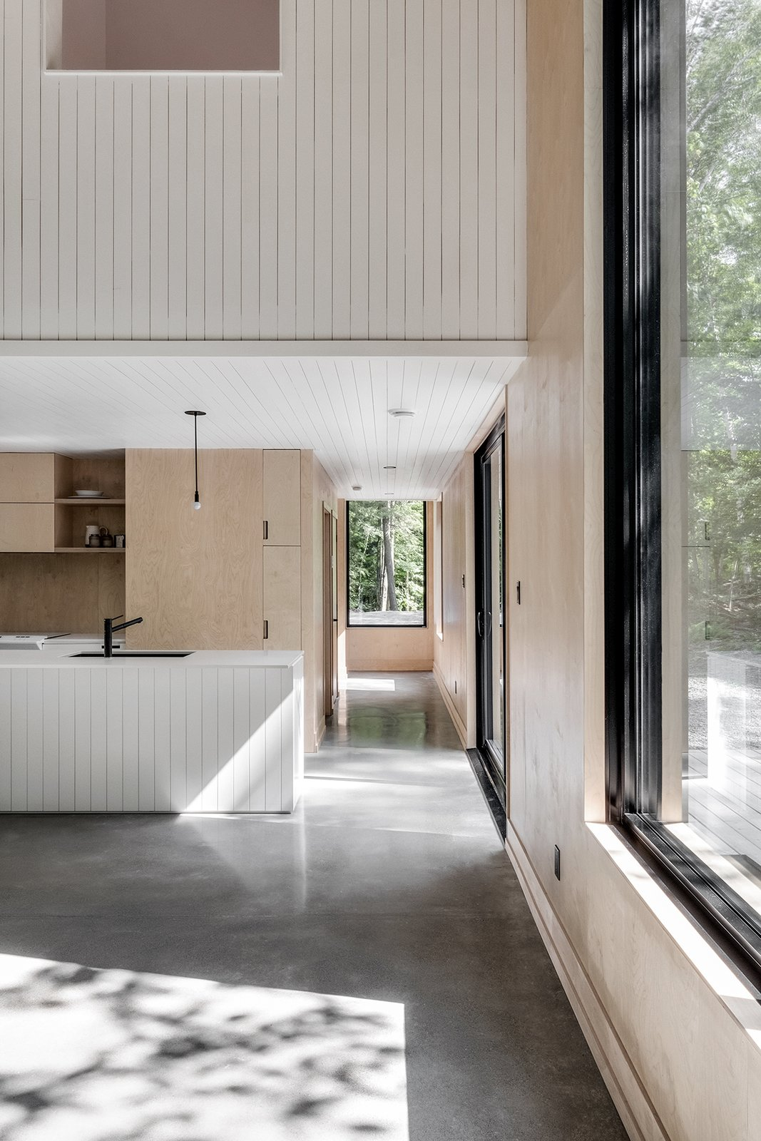 Hallway and Concrete Floor  Photo 7 of 17 in A Lofty Nature Retreat in Quebec Inspired by Nordic Architecture