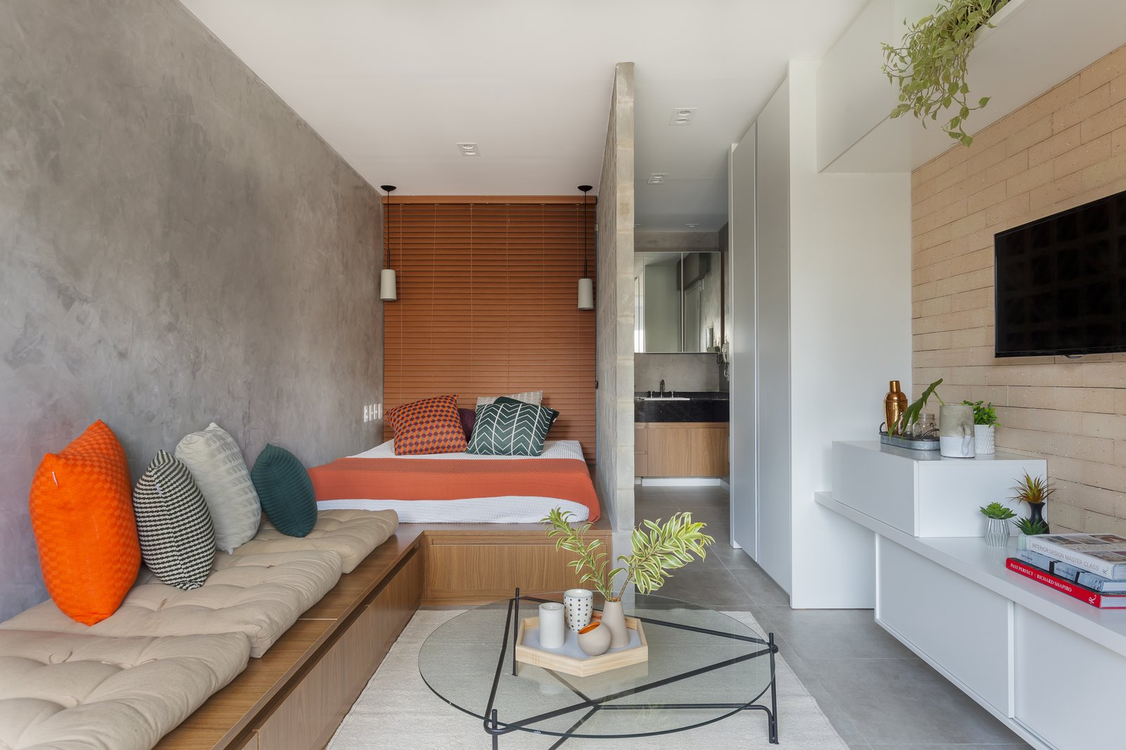 Living Room, Bench, Coffee Tables, and Recessed Lighting  Photo 1 of 9 in A 290-Square-Foot Apartment in São Paulo Takes Advantage of Every Inch
