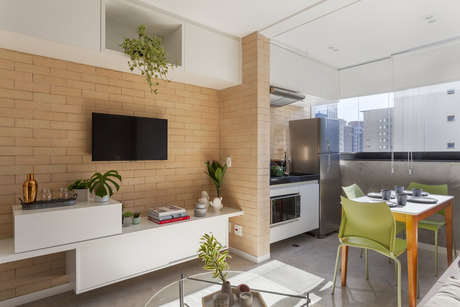 Living Room, Coffee Tables, Recessed Lighting, and Chair  Photo 5 of 9 in A 290-Square-Foot Apartment in São Paulo Takes Advantage of Every Inch