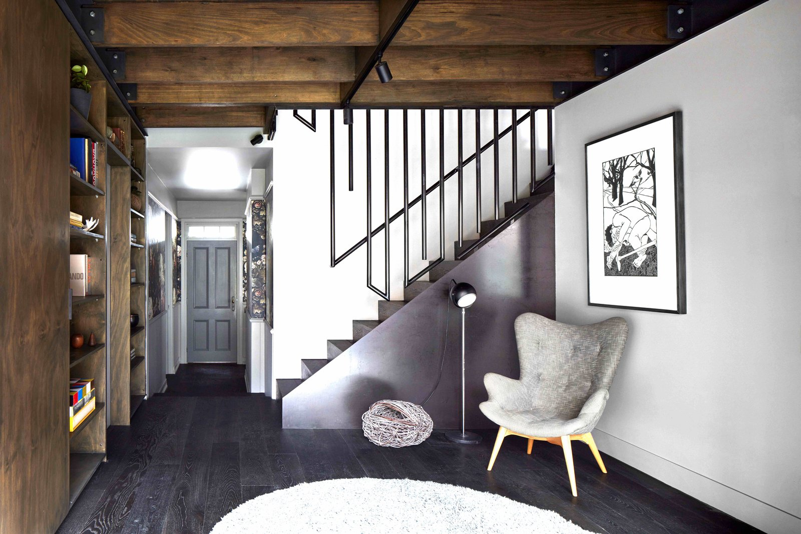 Tagged: Living, Chair, Shelves, Bookcase, Dark Hardwood, and Track.  Best Living Dark Hardwood Track Photos from One of Melbourne's Oldest Prefab Timber Cottages Gets a Second Chance