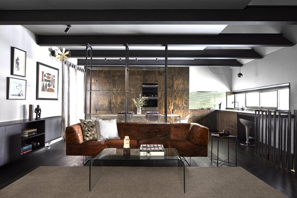 Tagged: Living, Sofa, Coffee Tables, Stools, Console Tables, End Tables, Ceiling, Track, Dark Hardwood, and Carpet.  Best Living Dark Hardwood Track Photos from One of Melbourne's Oldest Prefab Timber Cottages Gets a Second Chance