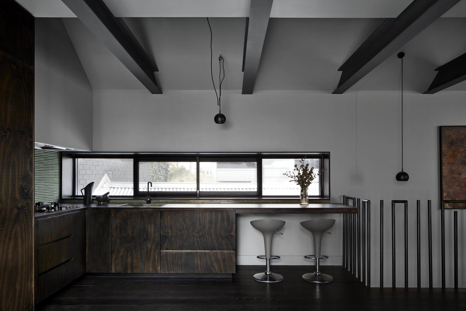 Kitchen, Range, Wood, Pendant, Drop In, and Dark Hardwood  Best Kitchen Wood Drop In Pendant Dark Hardwood Photos from One of Melbourne's Oldest Prefab Timber Cottages Gets a Second Chance