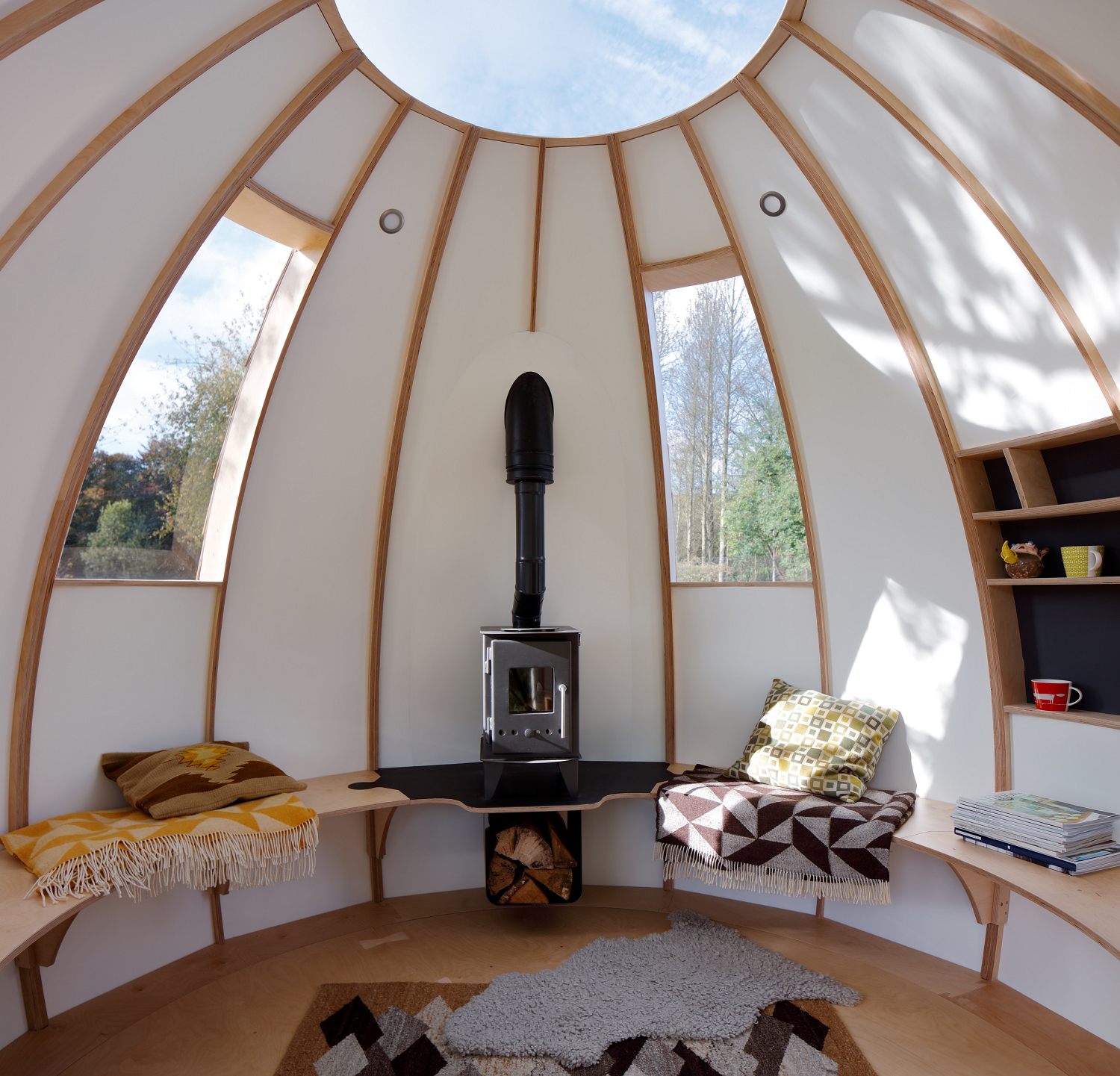 Living Room, Bench, Shelves, Light Hardwood Floor, and Wood Burning Fireplace  Best Photos from You Can Buy Your Very Own Prefabricated Escape Pod