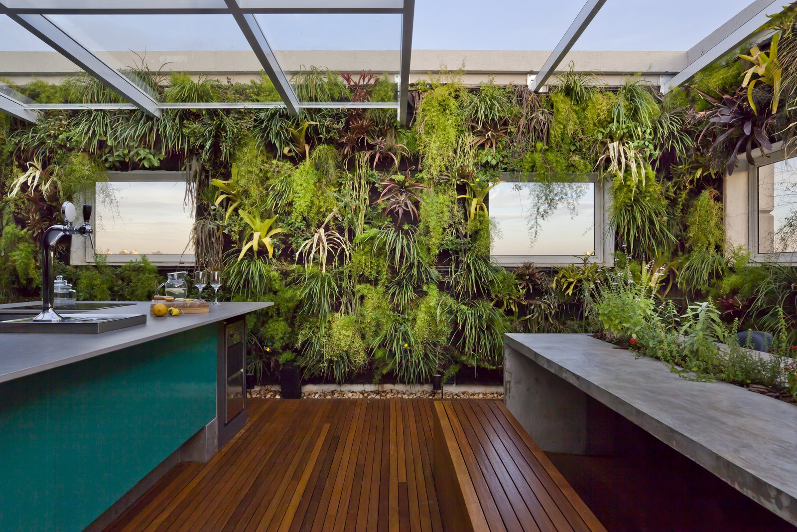 Dining Room, Bar, and Medium Hardwood Floor  Best Photos from Living Green Walls Bring Jungle Vibes Into a Brazilian Apartment