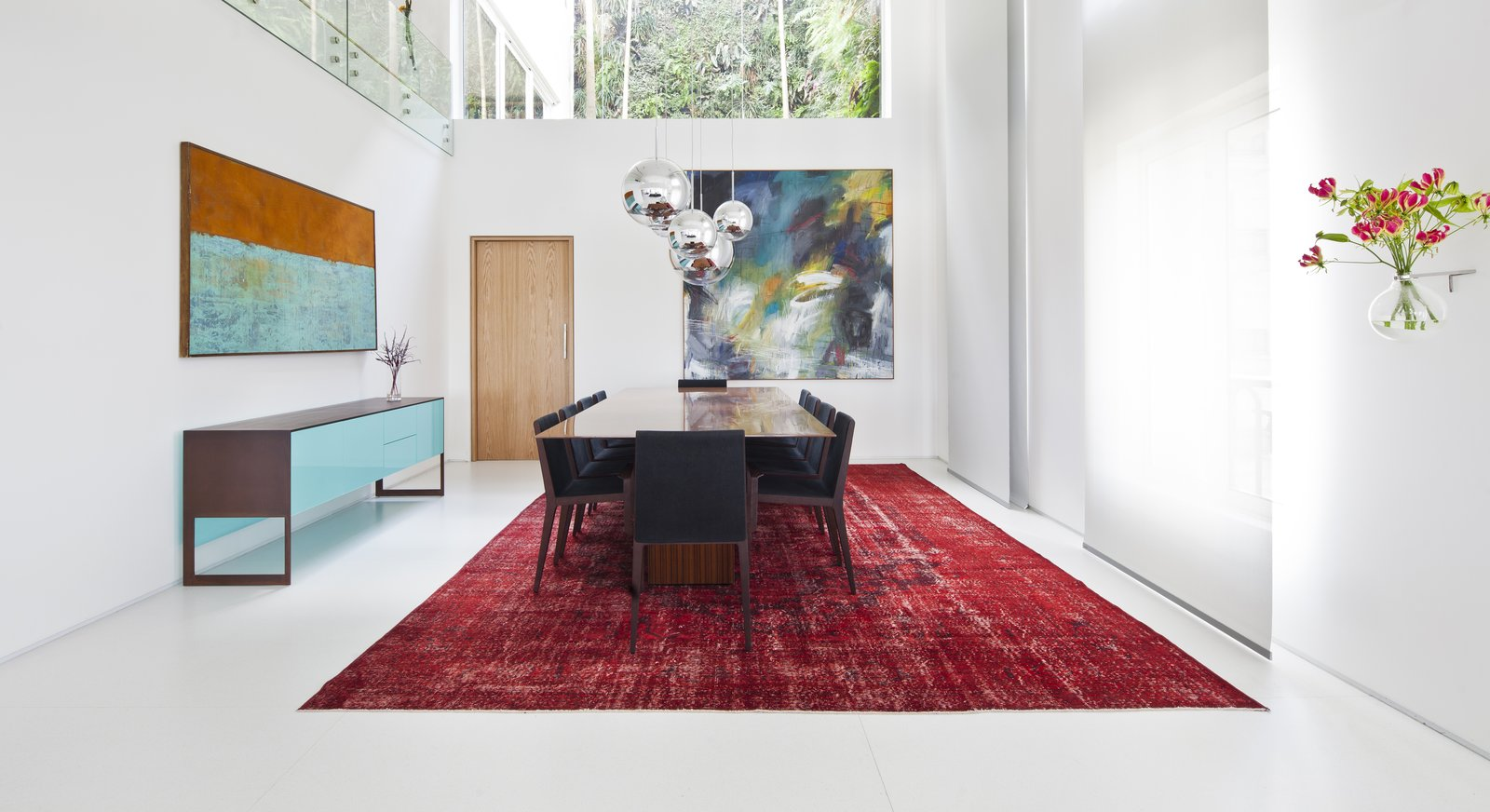 Dining Room, Chair, Rug Floor, Storage, Table, and Pendant Lighting  Best Photos from Living Green Walls Bring Jungle Vibes Into a Brazilian Apartment