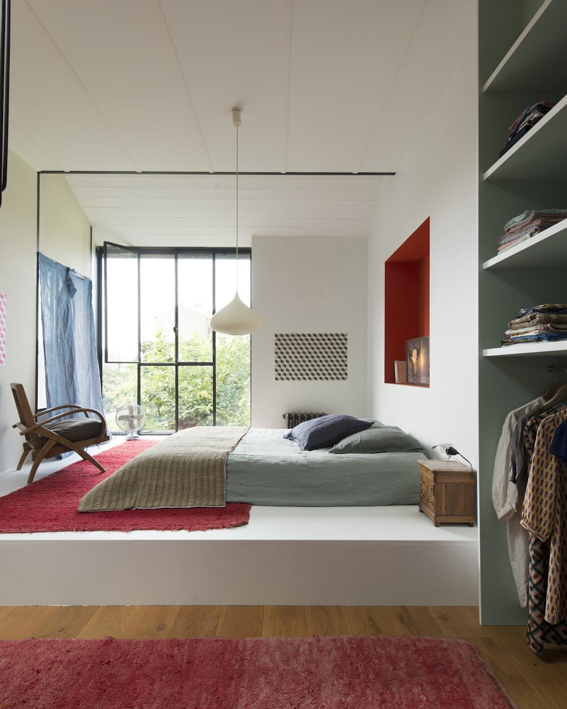 Bedroom, Bed, Chair, Pendant Lighting, Night Stands, Wardrobe, and Medium Hardwood Floor  Photo 2 of 9 in 8 Charming Parisian Apartments You'll Want to Book Right Now