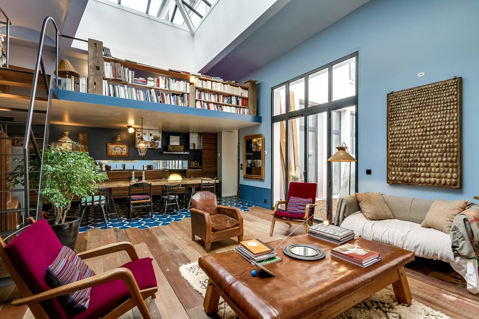 Living Room, Coffee Tables, Sofa, Chair, Bookcase, Floor Lighting, and Medium Hardwood Floor  Photo 4 of 9 in 8 Charming Parisian Apartments You'll Want to Book Right Now