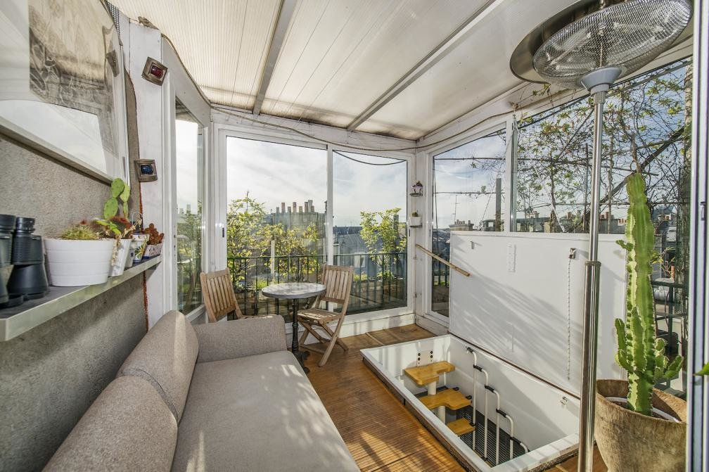 Living Room, Chair, and Sofa  Photo 3 of 9 in 8 Charming Parisian Apartments You'll Want to Book Right Now