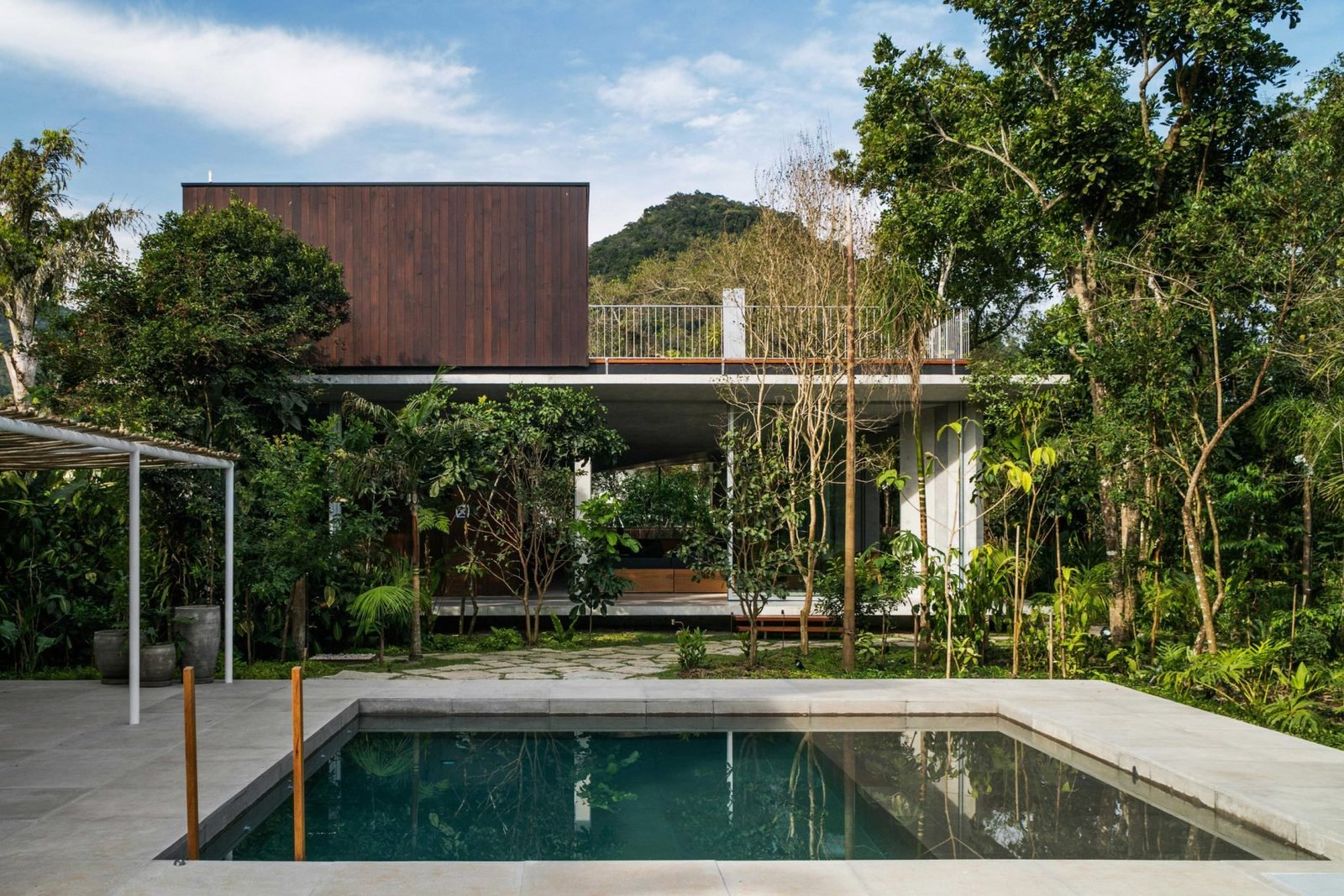 Outdoor, Trees, Plunge, Walkways, Hardscapes, and Concrete  Best Outdoor Concrete Plunge Photos from A Concrete Home in Brazil Lets the Owners Practically Live in the Jungle