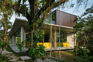 A Concrete Home in Brazil Lets the Owners Practically Live in the Jungle - Photo 8 of 12 -