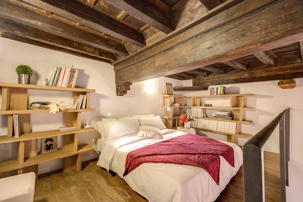 Bedroom, Bookcase, Bed, Medium Hardwood, Shelves, Table, Lamps, and Night Stands  Best Bedroom Shelves Bookcase Night Stands Photos from 7 Places to Rent For the Perfect Roman Holiday
