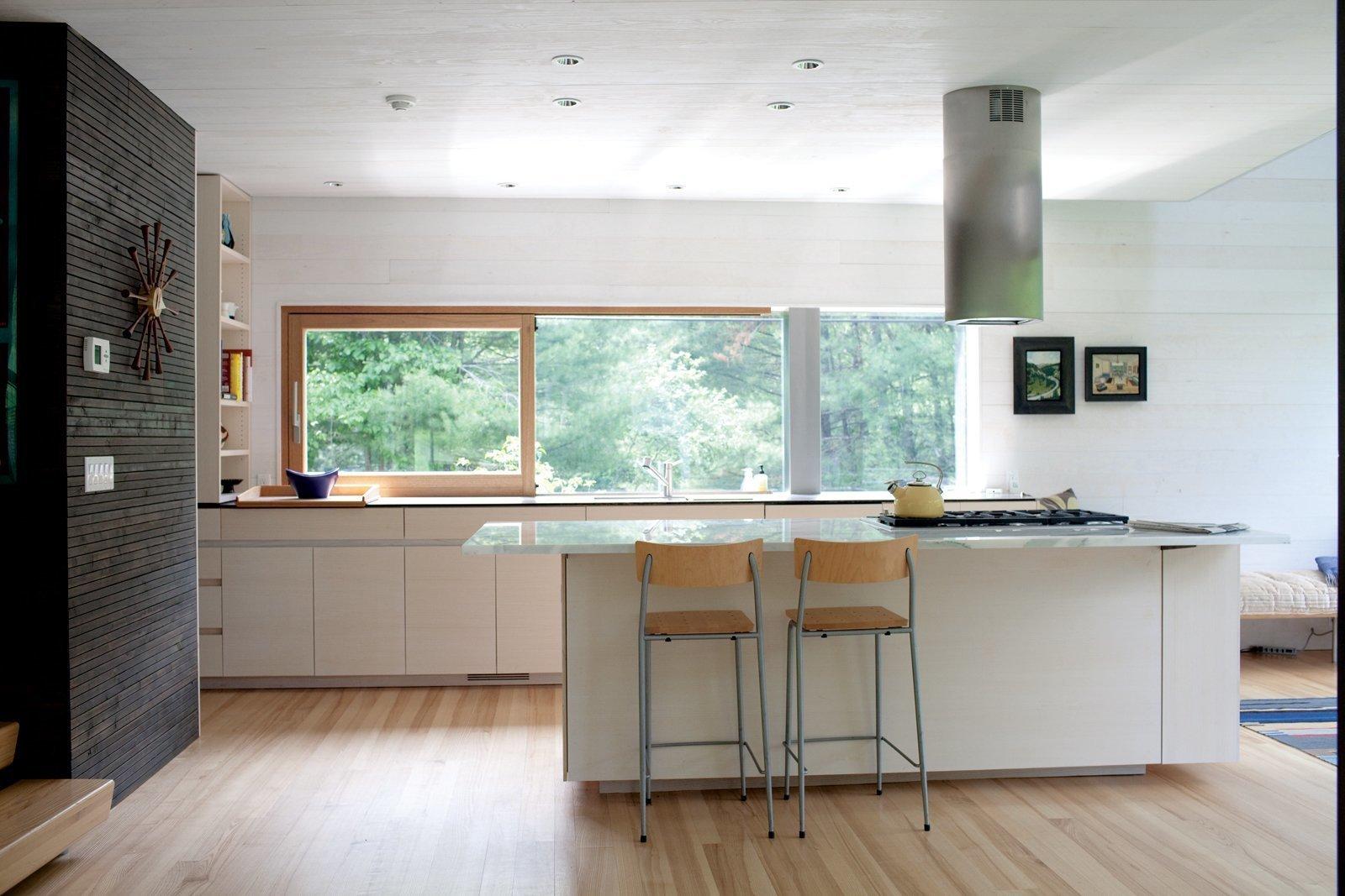 Kitchen, Range Hood, Open Cabinet, Light Hardwood Floor, Recessed Lighting, Range, and Undermount Sink  Photo 3 of 6 in 6 Integrated Appliances Sure to Make Your Kitchen Super Sleek