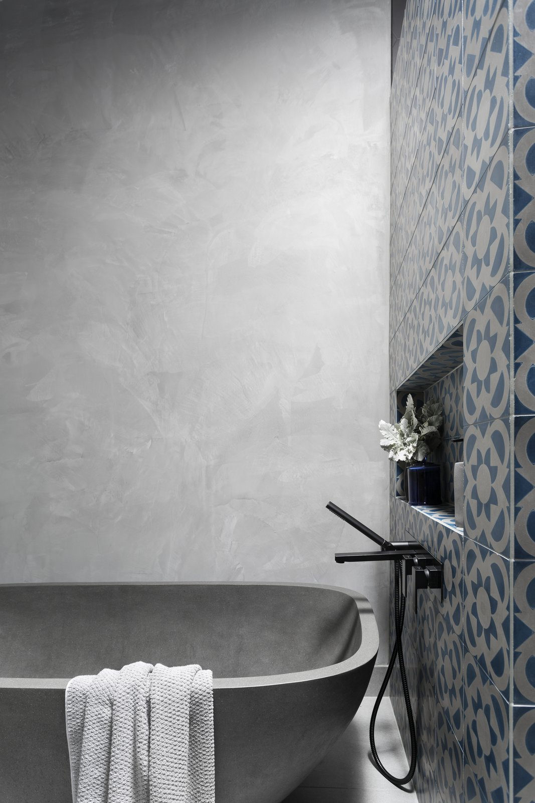 Bath Room, Ceramic Tile Wall, Concrete Wall, and Freestanding Tub  Photo 6 of 8 in 6 Insider Tips For Bathroom Design From the Experts
