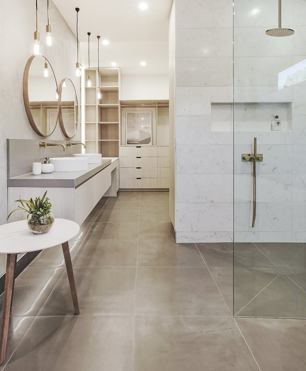 Bath Room, Enclosed Shower, Porcelain Tile Floor, Engineered Quartz Counter, Vessel Sink, and Pendant Lighting  Photo 5 of 8 in 6 Insider Tips For Bathroom Design From the Experts