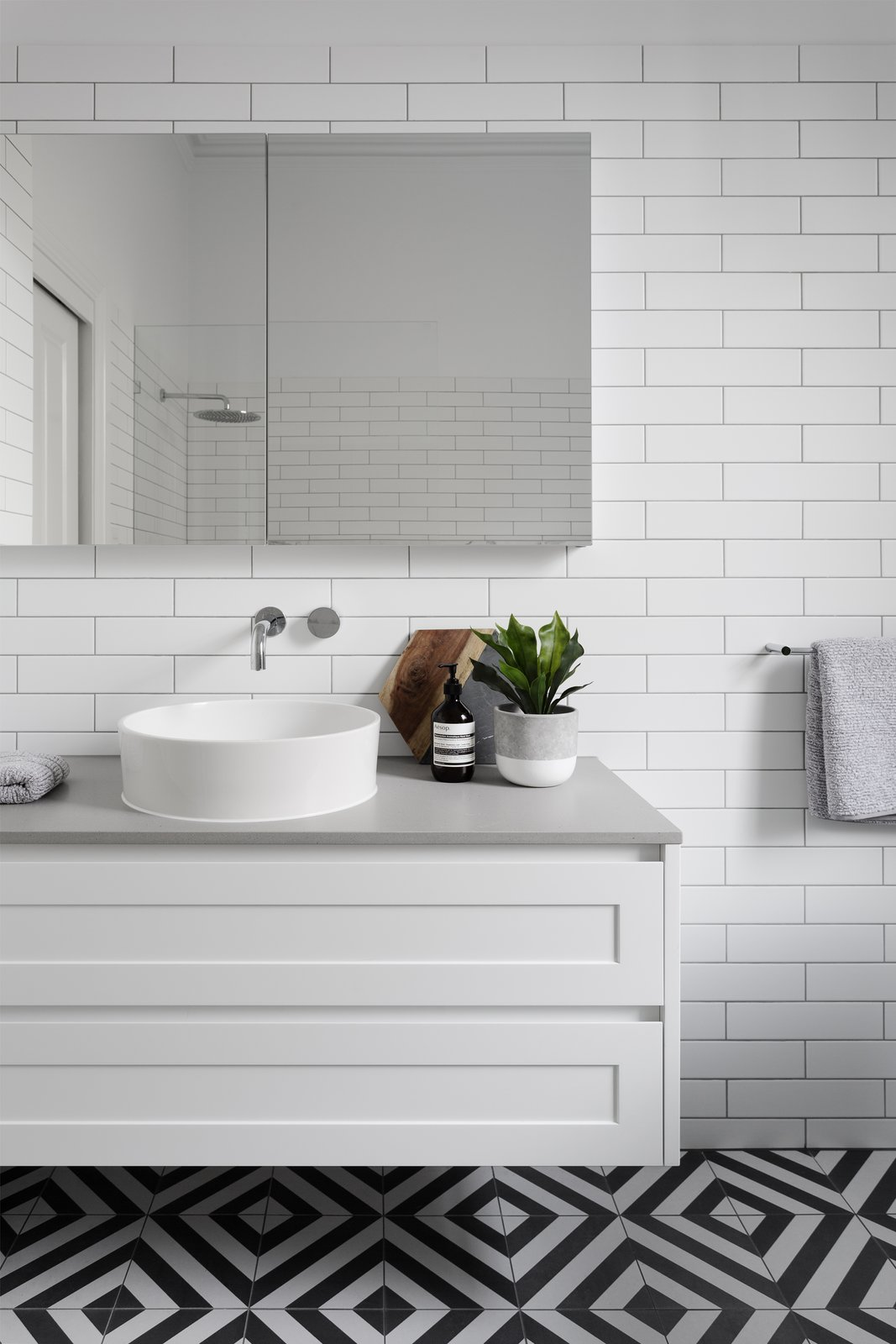 Bath Room, Subway Tile Wall, Engineered Quartz Counter, Vessel Sink, and Porcelain Tile Floor  Photo 8 of 8 in 6 Insider Tips For Bathroom Design From the Experts