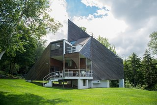 Pioneer of the design-build movement, David Sellers's Pyramid House on Prickly Mountain, Vermont, cuts a striking silhouette with a sharply angled roof, and a raised terrace in the front of the house.